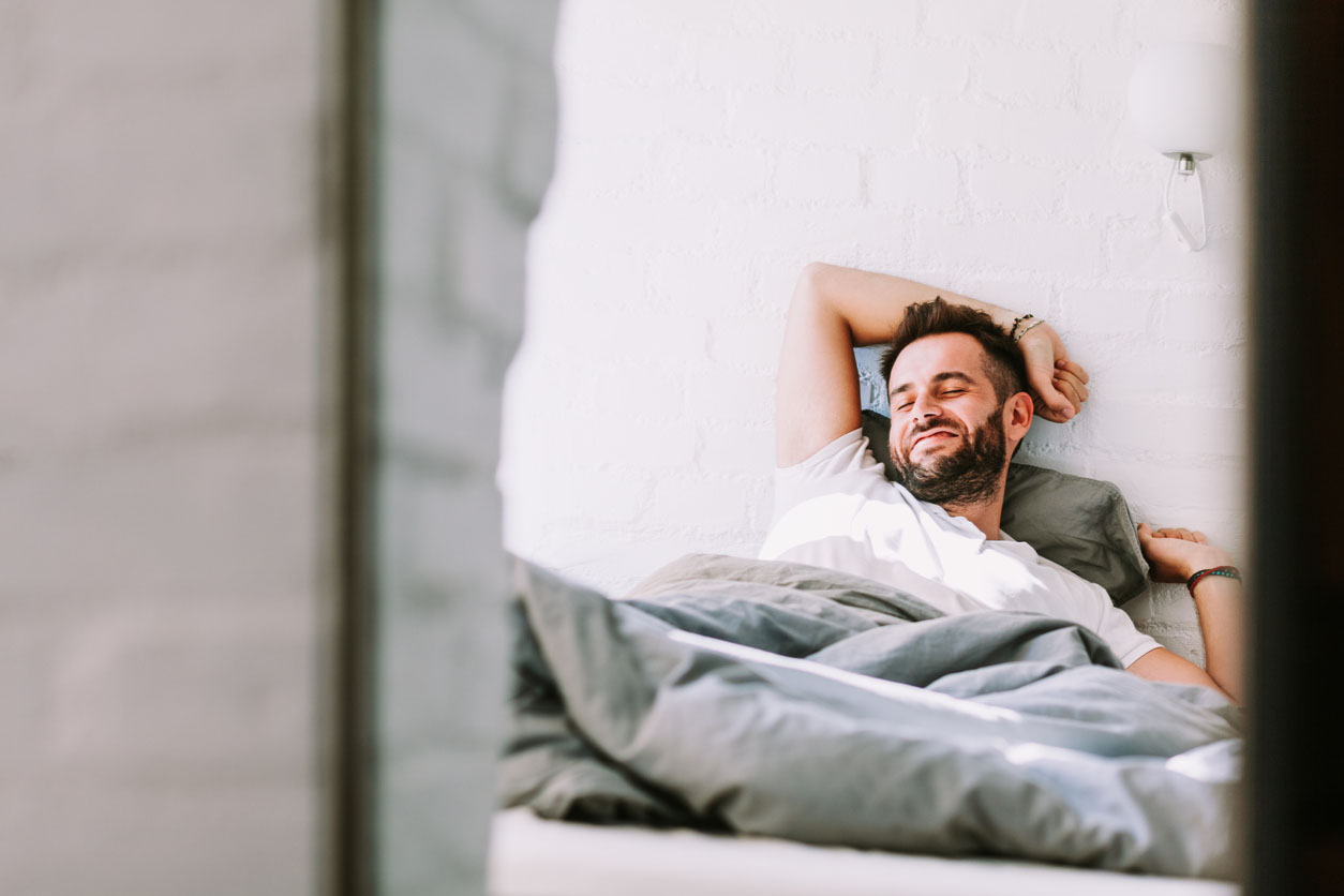 young-man-happy-bed.jpg